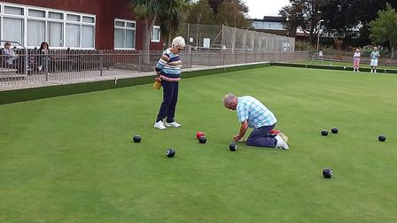 Ann checking Phil's measuring at the Sidmouth Bowls Club Fun day. Picture; CAROL SMITH