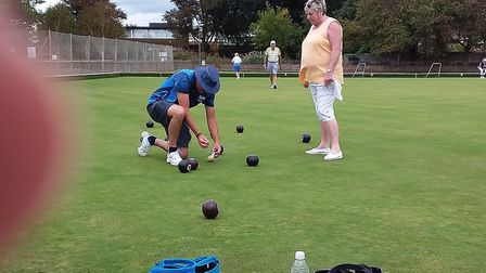 Elaine checking David's measuringat the Sidmouth Bowls Club Fun Day. Picture; CAROL SMITH