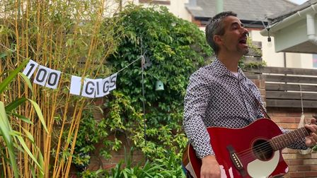 Ashley Leeds performing his 100th gig in his garden.