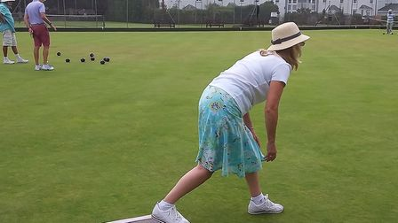 Action from Sidmouth Bowls Club member Carol watching her wood make its way down the green. Picture; CAROL SMITH