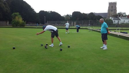 Action from Sidmouth Bowls Club and David giving directions. Picture; CAROL SMITH