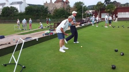 Action from Sidmouth Bowls Club and Tony (or is that Anthony) egging his team on. Picture; CAROL SMITH