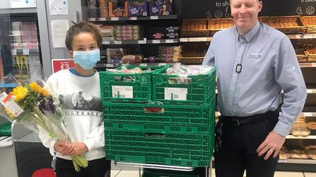 Volunteers collect surplus food from the Co-op. Picture: SAVE