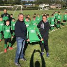 John Emmott from Emm-Lec Construction with Stuart Cload, under-11s manager, and squad. Picture: James Patmore