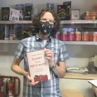 Carl East at Winstone's bookshop with a copy of Sasha Swire's book. Picture: Maria McCarthy