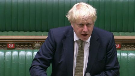 Prime Minister Boris Johnson making a statement in the House of Commons , setting out a new three-ti