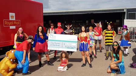 Evette Chapman and her colleagues at the Post Office in fancy dress. Picture: BBC Radio Somerset