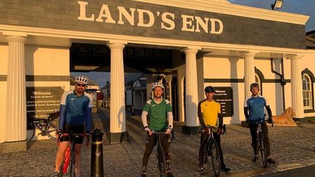 Teachers Andy Watts, Kevin Bowen, Mark Armstrong and Steve Holland who cycled from Land's End to Han
