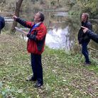 Dr Fox and villagers looking at the development site near Ham Green Lake.