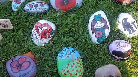PoppyRocksWeston The memorial area of Grove Park was decorated with 100 painted rocks in 2018, ma