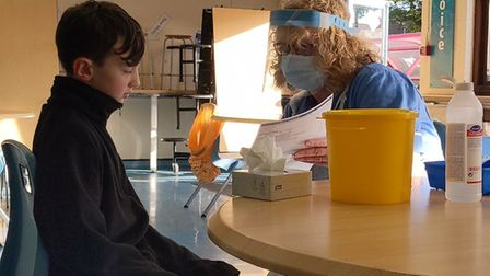 Morgan and Allyson discussing the consent form before the flu vaccination.