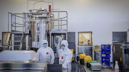 Staff at a laboratory in Melbourne, Australia, which is about to start manufacturing a Covid-19 vaccine
