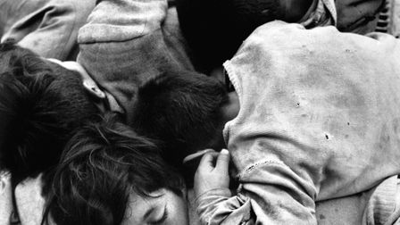 Sergio Larrain's Children sleeping over a grill which is heated from underneath, CHILE. Santiago. 19