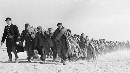 Exiled Republicans being transferred from one part of an internment camp for Spanish refugees tp ano