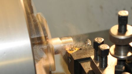 On the lathe screw cutting the T3's barrel