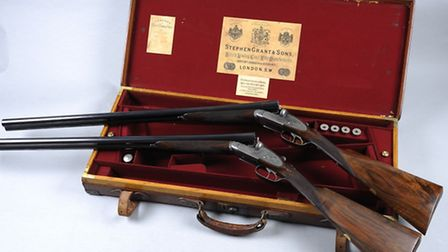 A pair of 12-bore sidelock ejector guns, built in 1915. Sold for £8,400 at a Stephen Grant & Sons au