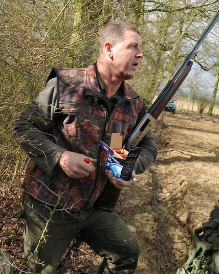 """""""Duck!"""" Andy quickly puts a cartridge in the gun, aims and the first pigeon of the day is down"""