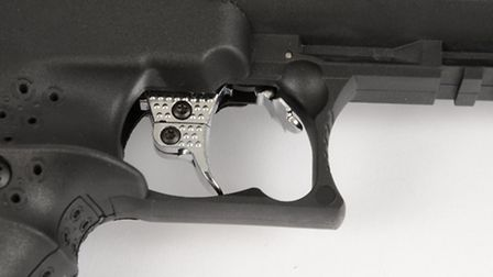 The automatic safety sits directly in front of the trigger blade.