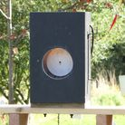 """At 6 yards, that 3/8"""" hole in the bell target is tiny, especially over open sights."""