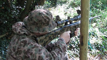 Matching cammo and vintage Jackal rifle.