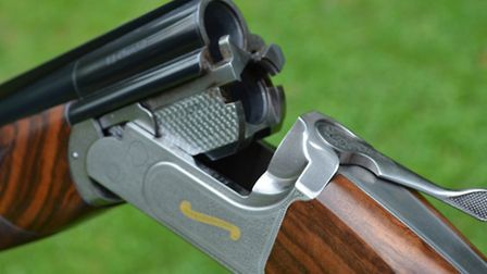 Smartly scroll-engraved Churchill Coronet built in association with Zoli