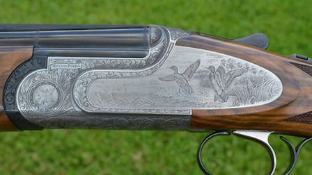 The attractive engraving is befitting of a more expensive gun