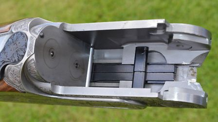 The action is a bifurcated lump design with Browning-style locking