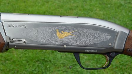 The gilded birds adorning the brushed nickel receiver may not be to everyone's taste
