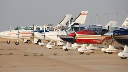 A Group preparing to depart from the dusty tarmac in North Africa