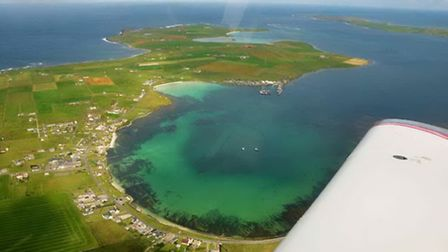 The town of Westray, Orkney with the airfield in the distance at the top of the photo