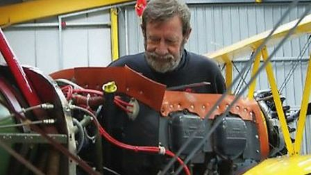 Chris Rollings at work on a Pitts Special in Tiger Airways' hangar