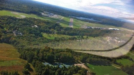 Just rolling wings-level for final to land on Runway 29 at Westchester County Airport