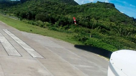Short final for St Barths Runway 28, where the surrounding high ground permits no go-around