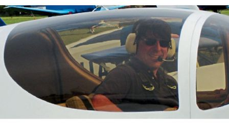 Inspector Alan Thorne at the controls of G-TSUE