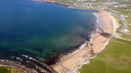 The beach and clear, blue — but absolutely frigid — waters at Spanish Point, served by a nearby airf