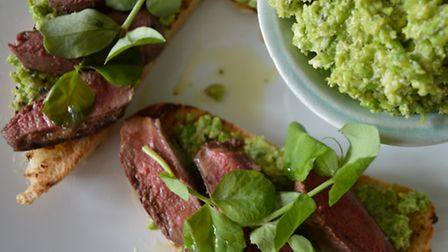 Spread the puree over the crostini, arrange the pigeon on top and garnish with pea shoots