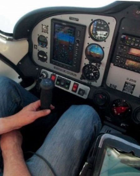 Col strikes a relaxed pose at the controls; and G-ZOOB at rest at Elba — two hours flown, ten to go.