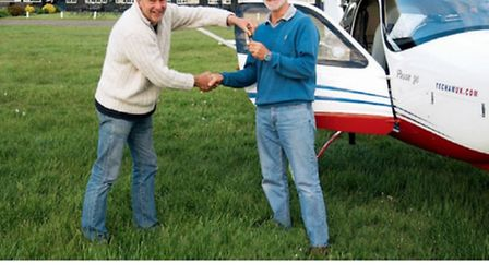 Not wrestling, but handing over the keys to aircraft owner Tim Orchard of Tecnam UK