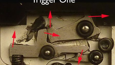 The photograph 'Trigger One' shows the trigger unit at rest