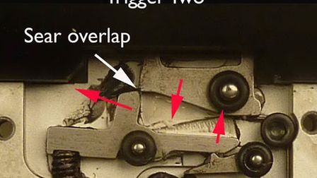 The photograph 'Trigger Two' shows the cocked trigger unit