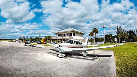 On the apron at Everglades Airport; a tight runway with water at both ends, but what better way to a