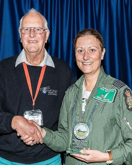 Nikki being presented with a plaque from Stow Maries volunteer Geoff Charge. Photograph take by Davi