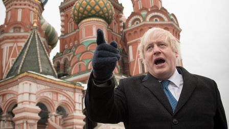 British Foreign Secretary Boris Johnson stands in front of Saint Basil's cathedral in Red Square in
