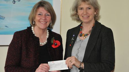 WLAC MD Catherine Smith (right) presents the cheque to Cdr Sue Eagles - PHOTO: PHILIP WHITEMAN