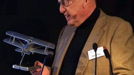 Stephen contemplates the trophy, a sold silver model of a Sopwith Camel PHOTO: Philip Whiteman