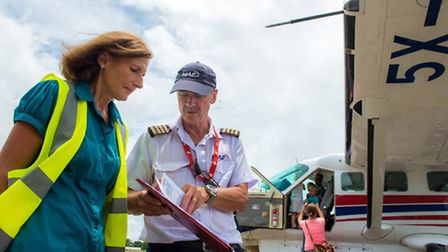 Margrit and Emil at work on pre flight checks
