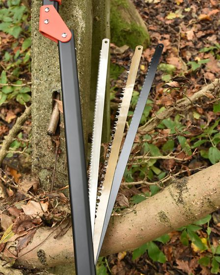 Three different blades are stored safely in the frame