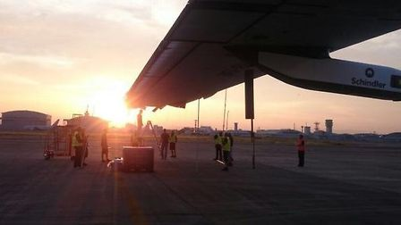 Solar Impulse tied down by ground crew after unexpected intermediate landing in Japan due to worseni
