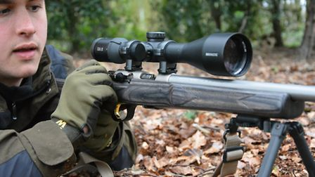 Browning T-Bolt was really fast when shot left handed with dual controls from a bipod