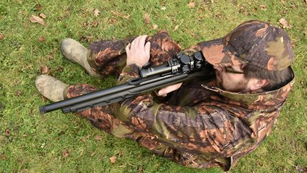 In the sitting position, seen from above, you can see just how short the rifle is